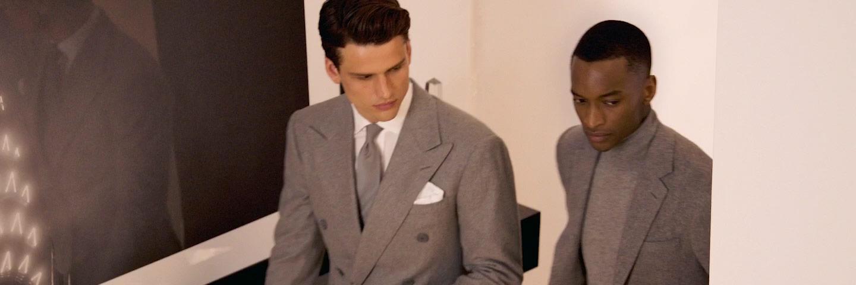 Men in grey suit jackets