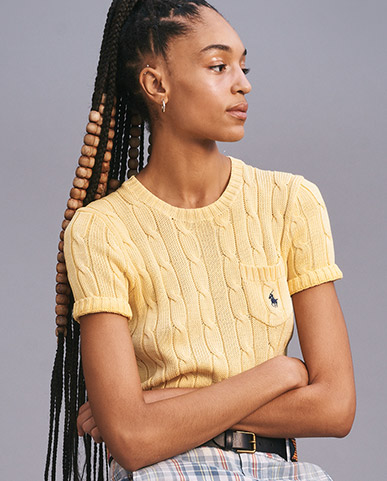 Woman in yellow cable short-sleeve sweater