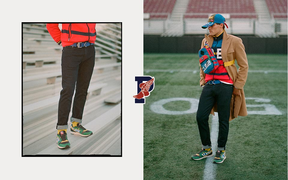 Man on football field in color-blocked top paired with black jeans