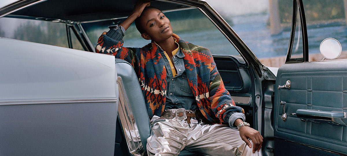 Woman in multicolored Southwestern-motif cardigan & denim shirt
