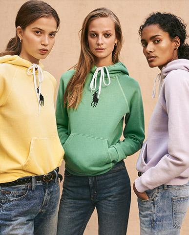 Women in faded pastel-hued hoodies & jeans