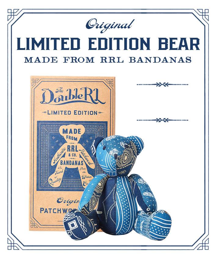 Stuffed teddy bear made with blue bandanna-print patchwork exterior