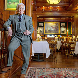 Ralph in grey 3-piece suite in The Polo Bar dining room
