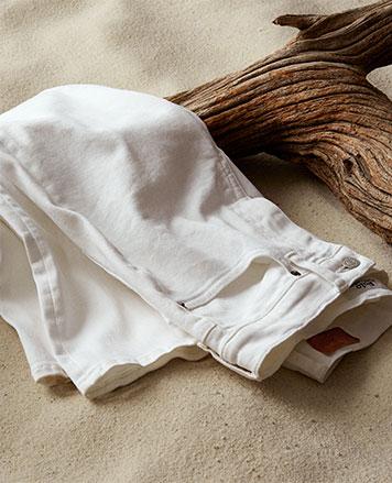 Folded white jeans