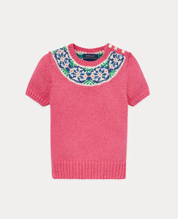 Pink short-sleeve sweater with stitched pattern at the collar.