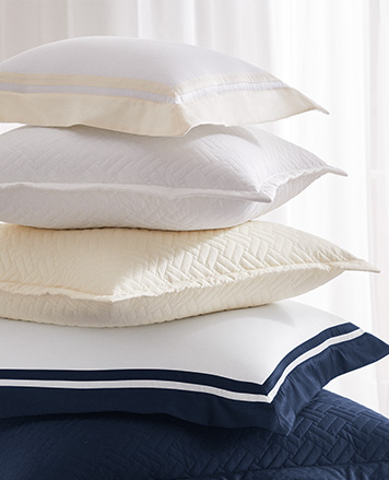 Pile of throw pillows with different shams
