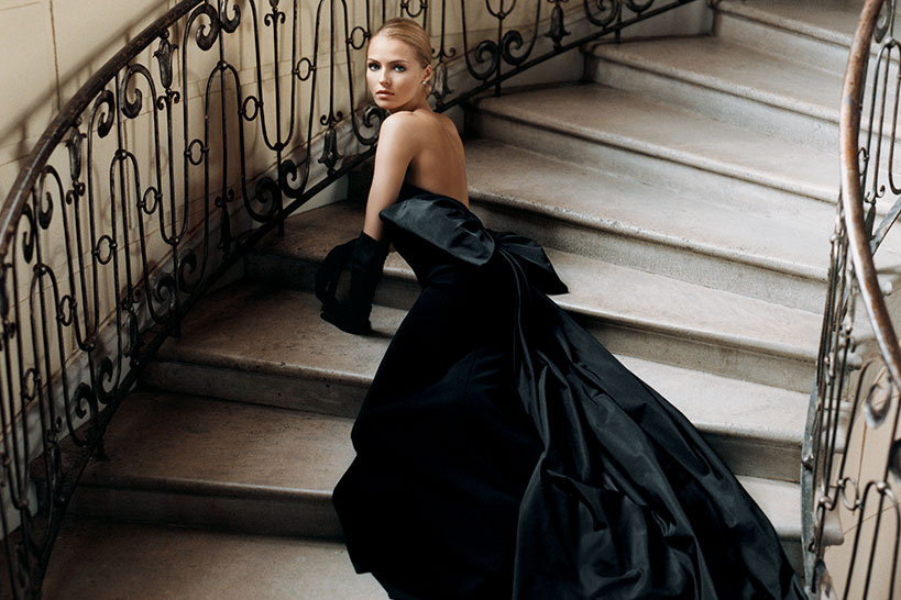 Model in black ballgown on staircase