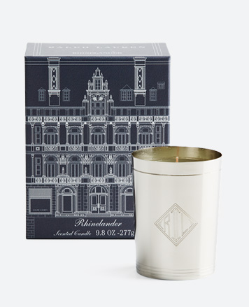 Lit candle in silver holder accented with 'RL' monogram
